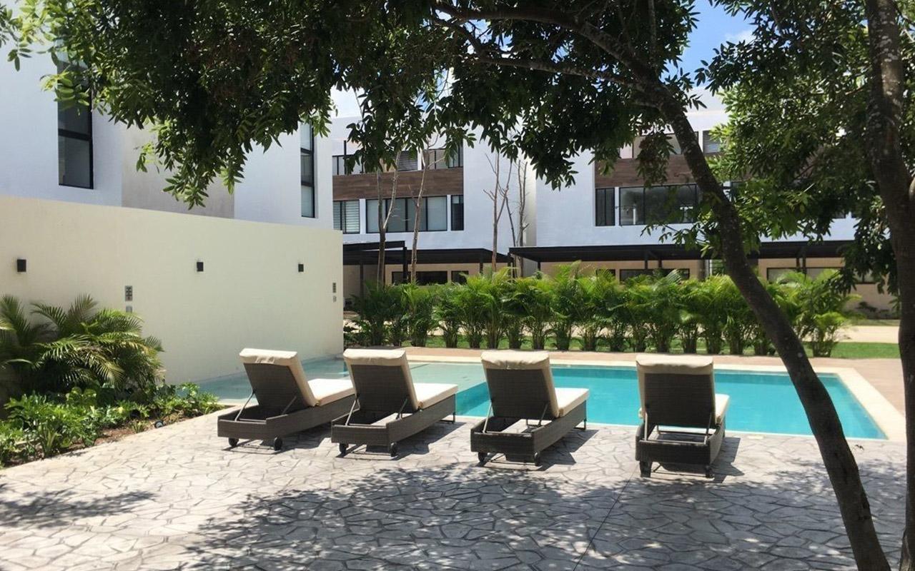 Vista exterior amenidades y piscina en Zen apartments & homes, Montebello, Mérida.